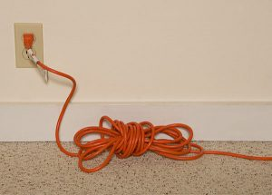 Extension cord plugged into electrical receptacle