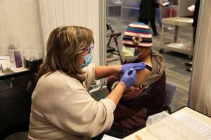 A woman receives a COVID-19 vaccination at the UNC Health clinic at the Friday Center. (Photo courtesy UNC Health)